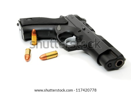 pistol with ammo isolated - stock photo