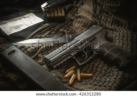 pistol with bullet for background - stock photo