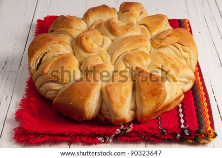 Pita bread baked in Bulgaria for Christmas with a coin inside for luck and prosperity - stock photo