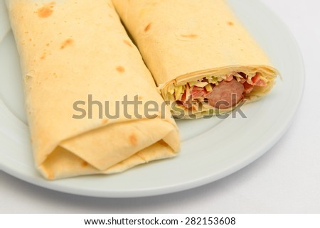 pita bread roll with sausage and salad