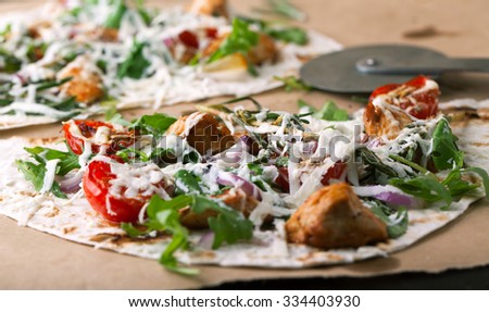 Pita bread with roasted vegetables with herbs and cheese - stock photo