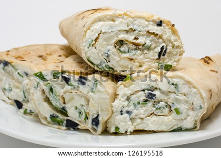 Pita bread wrapped with cottage cheese and vegetables - stock photo