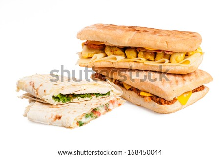 Pita sandwich with cheese and panini with meat isolated on white background - stock photo
