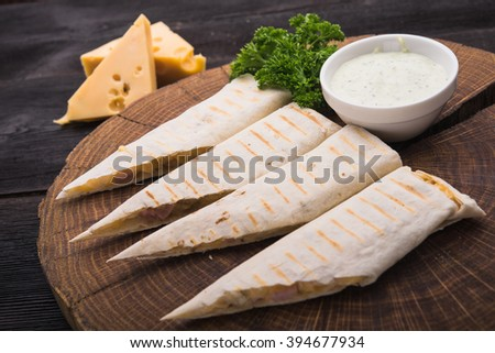 pita with cheese on wood board