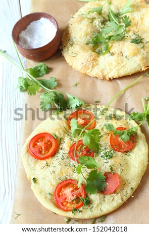 pita with tomatoes and cheese, focaccia, food close up - stock photo