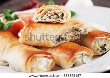 Pita zeljanica, balkans phyllo pastry pie filled with spinach and cheese