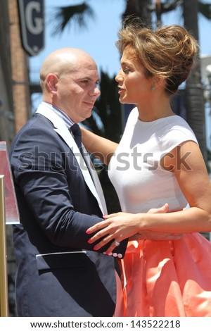 Pitbull and Jennifer Lopez at the Jennifer Lopez Star on the Walk of Fame ceremony, Hollywood, CA 06-20-13 - stock photo