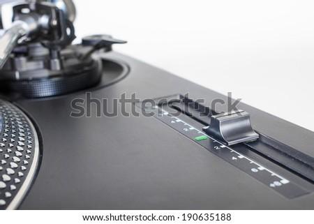 Pitch adjustment knob of a classic DJ turntable - stock photo