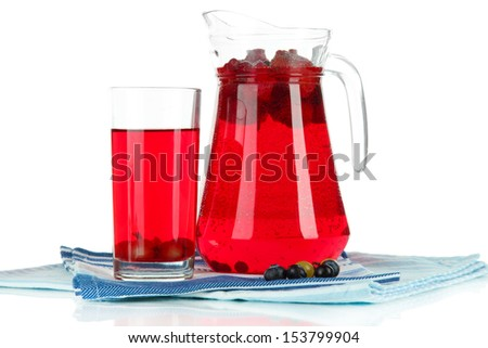 Pitcher and glass of compote on napkins isolated on white