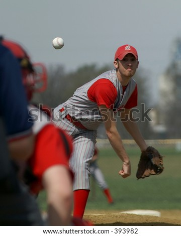 pitcher delivers pitch - stock photo