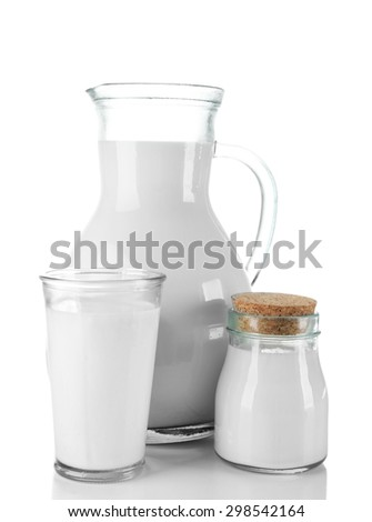 Pitcher, jar and glass of milk on wooden table, on white background - stock photo
