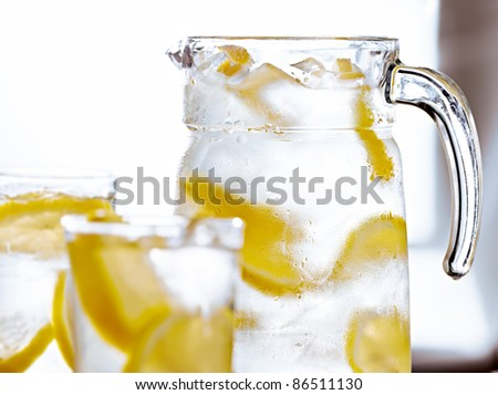 pitcher of lemonade shot with selective focus. - stock photo