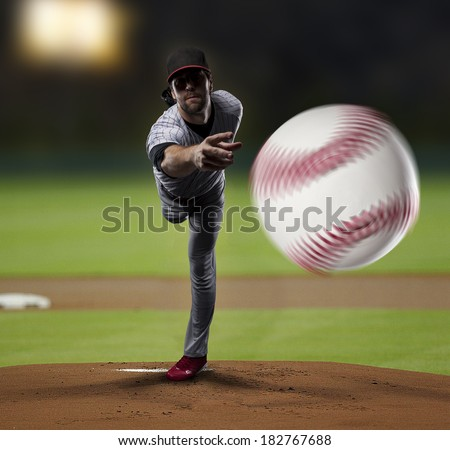 Pitcher  Player throwing a ball, on a baseball Stadium. - stock photo