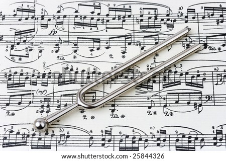 Pitchfork on sheet music, abstract art background - stock photo