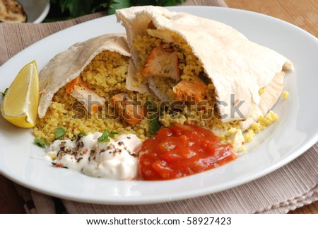 Pitta bread stuffed with couscous and chicken - stock photo
