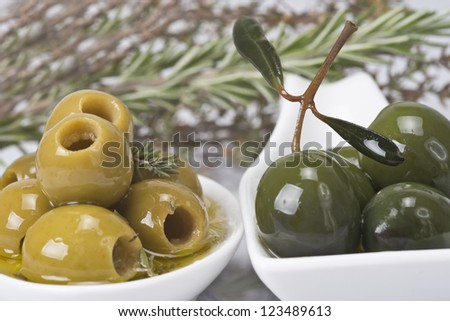 Pitted olives in a saucer isolated on a white background.