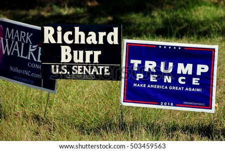 Pittsboro, NC - October 23, 2016:  Campaign 2016 political advertising signs for both local and national candidates at the intersection of two rural roads