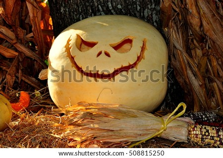 Pittsboro, North Carolina - October 30, 2016:  A carved jack-o-lantern with eerie smile at the annual Fearrington Village Halloween event