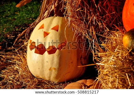 Pittsboro, North Carolina - October 30, 2016:  Bales of hay and carved pumpkin at the annual Fearrington Village Pumpkinfest Halloween event