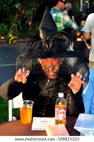 Pittsboro, North Carolina - October 30, 2016:  Lady with sparkling blue eyes dressed in a witch costume at the Fearrington Village Halloween event