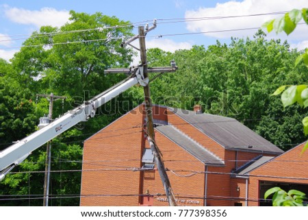 PITTSBURGH ,PA  JUNE 1, 2017: Duquesne Light Co. Road Crew Replacing