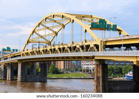 Pittsburgh, Pennsylvania - city in the United States. Fort Duquesne bridge over Allegheny River. Double-decked Bowstring Arch bridge - stock photo