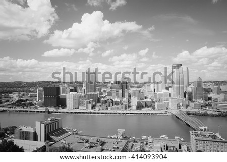 Pittsburgh, Pennsylvania - city in the United States. Skyline with Monongahela River. Black and white vintage style. - stock photo