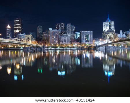 Pittsburgh Pennsylvania waterfront and bridges late at night.