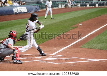 PITTSBURGH - SEPTEMBER 24 : Andrew McCutcheon of the Pittsburgh Pirates swings at a pitch against the Cincinnati Reds on September 24, 2009 in Pittsburgh, PA. - stock photo
