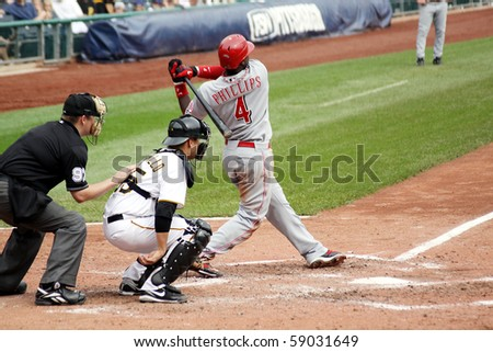 PITTSBURGH - SEPTEMBER 24 : Brandon Phillips of the Cincinnati Reds swings at a pitch against the Pittsburgh Pirates on September 24, 2009 in Pittsburgh, PA.