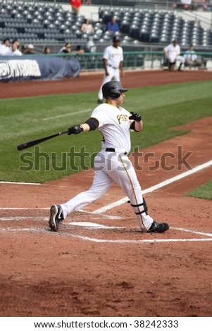 PITTSBURGH - SEPTEMBER 24 : Jason Jaramillo of Pittsburgh Pirates swings at a pitch against Cincinnati Reds on September 24, 2009 in Pittsburgh, PA.