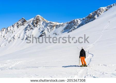 PITZTAL GLACIER, AUSTRIA - MAR 29, 2014: woman skier in Austrian ski resort of Pitztal, Austrian Alps.  - stock photo