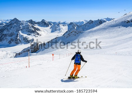 PITZTAL GLACIER, AUSTRIA - MAR 29: Woman skier on slope in the mountains of Pitztal winter resort on 29th March 2014, Austrian Alps  - stock photo