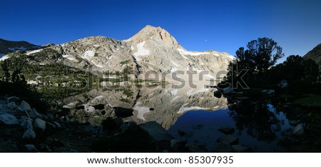 Piute Lake with reflection of peak in the early morning - stock photo