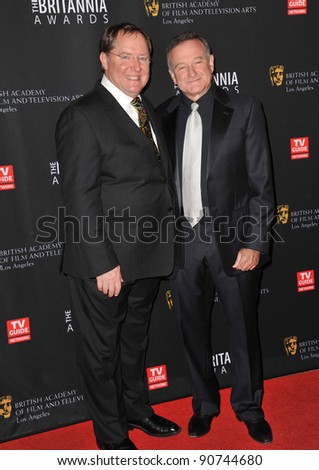 Pixar boss John Lasseter (left) & Robin Williams at the 2011 BAFTA/LA Britannia Awards at the Beverly Hilton Hotel. November 30, 2011  Beverly Hills, CA Picture: Paul Smith / Featureflash - stock photo