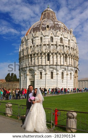 PIZA, ITALY - MARCH 24: Long queue of people for ticket to leaning tower in Piza and fragment of wedding on March 24, 2015 in Piza, Italy. - stock photo
