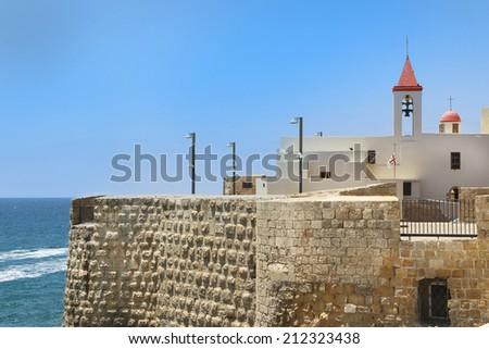 Pizani harbor walls and St. John church in Acre, israel - stock photo