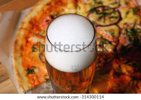 pizza and a glass of beer - stock photo