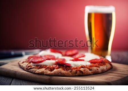 Pizza and Beer - stock photo