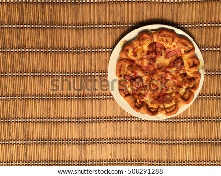 Pizza and dish on wood table backgroud