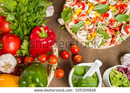 Pizza and fresh ingredients - stock photo
