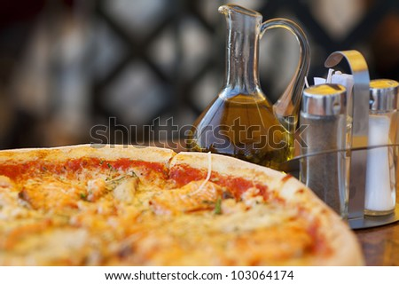 pizza and olive oil on restaurant table