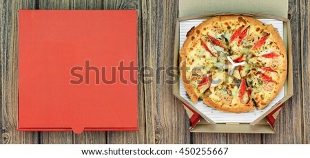 Pizza and the delivery box on wooden background, Fast food.