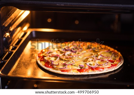 Pizza baking in the oven