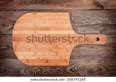 pizza board on old table - stock photo
