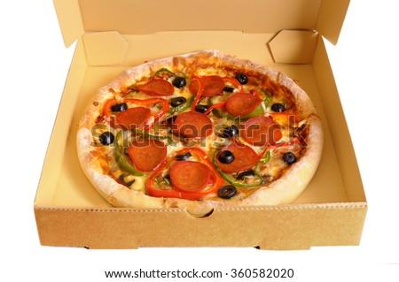 Pizza box, pepperoni pizza inside, deep crust - stock photo