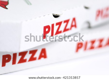 Pizza boxes, closeup shot with selective focus