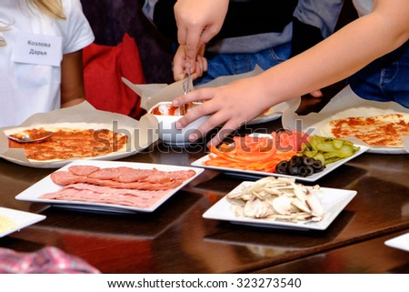 pizza children on a master class at the restaurant - stock photo