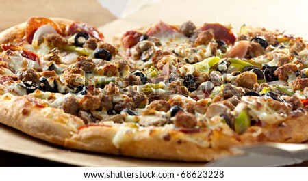 Pizza closeup with supreme toppings - stock photo