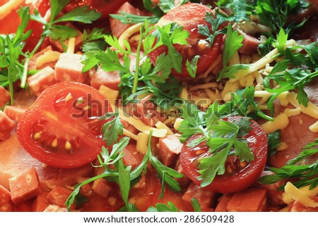 pizza cooking tomato sauce cheese sausage - stock photo